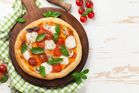 Italian pizza with tomatoes, mozzarella and basil. Top view with space for your text Stok Fotoğraf