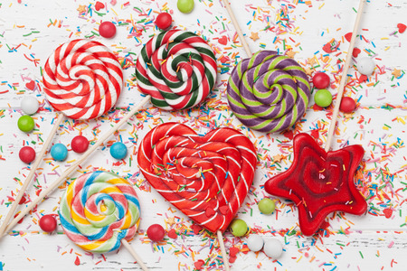 Colorful sweets. Lollipops, macaroons, candies. Top view