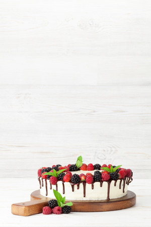 Cheese cake with chocolate and berries. With space for your greetings Stock Photo