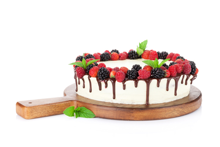 Cheese cake with chocolate and berries. Isolated on white background