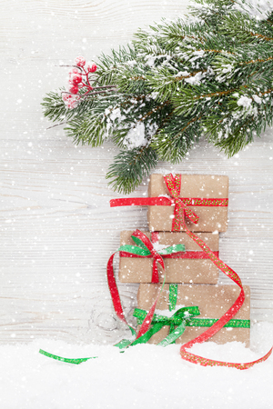 Christmas gift boxes and xmas fir tree branch. View with space for your greetings 版權商用圖片