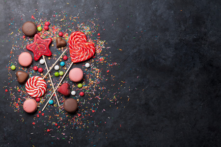 Colorful sweets. Lollipops, macaroons, candies. Top view with space for your text