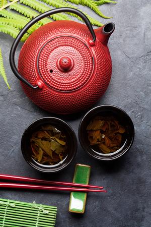 Green tea and sushi chopsticks. Japanese meal set. Top view