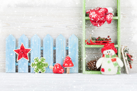 Christmas snowman toy and decor. Xmas greeting card with space for your greetings