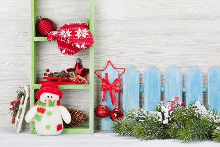 Christmas snowman toy, decor and fir tree branch. Xmas greeting card with space for your greetings
