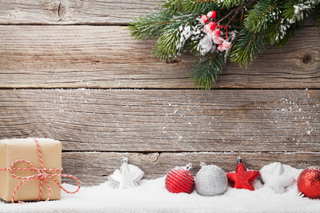 Christmas gift box, decor and xmas fir tree branch. View with space for your greetings