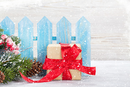 Christmas gift box and xmas fir tree branch. View with space for your greetings