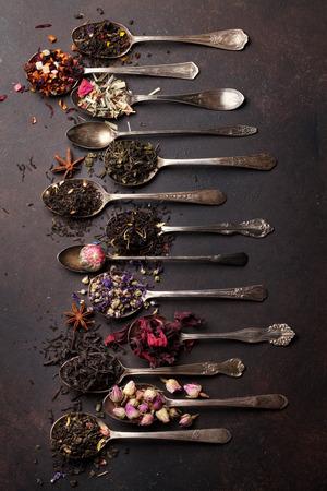 Various tea in vintage spoons. Black, green and red tea. Top view