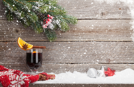 Christmas card with mulled wine hot drink, mittens and xmas fir tree branch. View with space for your greetings
