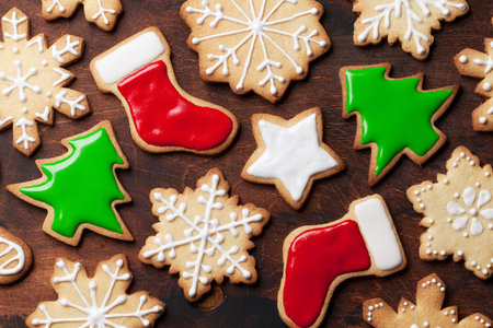 Christmas gingerbread cookies over wooden backdrop. Top view