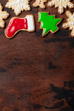 Christmas card with gingerbread cookies on wooden table. Top view with space for your greetings Stock Photo