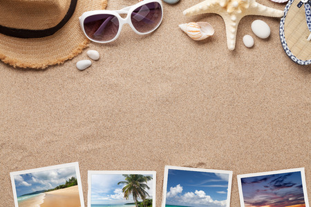 Travel vacation background concept with sunglasses, beach hat, seashells and photos on sand backdrop. Top view with copy space. Flat lay. All photos taken by me