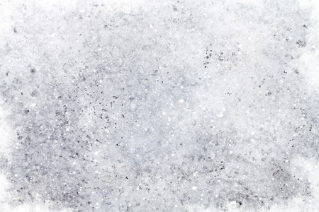 Light gray stone texture background with snow and frost. Christmas backdrop