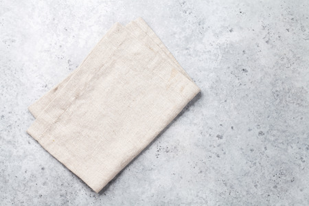 Cooking stone table with kitchen towel or napkin. Top view with space for your meal or recipe