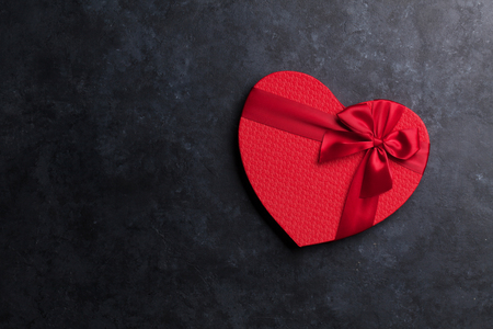 Heart shaped Valentines day red gift box. Top view with space for your greetings Stock Photo
