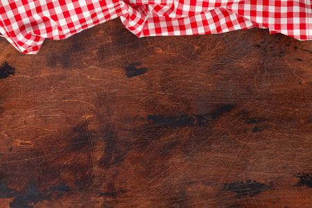 Cooking wooden table with kitchen towel or napkin. Top view with space for your meal or recipe Stock Photo