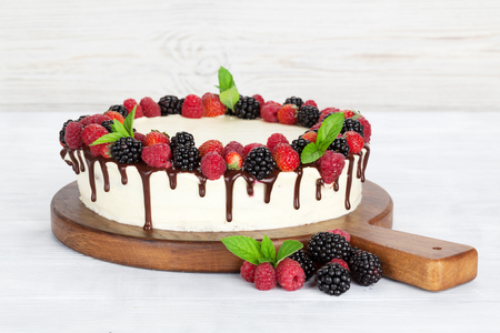 Cheese cake with chocolate and berries. With space for your greetings Stockfoto