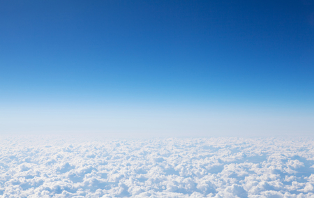 Blue sky and clouds with copy space. View from airplane