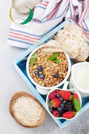 Healthy breakfast set with muesli, berries and milk. Top view
