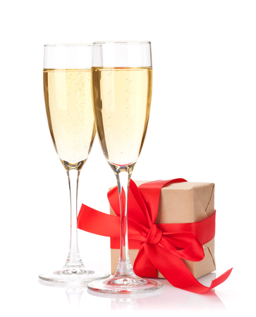 Valentines day gift box and champagne glasses. Isolated on white background