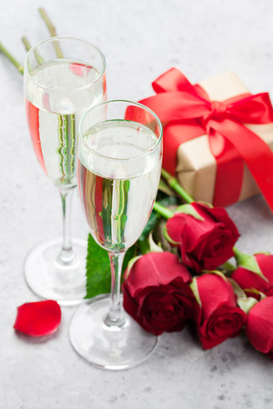 Valentine's day greeting card with champagne, gift box and rose flowers