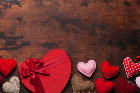 Valentine's day greeting card with handmaded heart toys and love gift box on wooden background. Top view with space for your greetings. Flat lay 写真素材 - 114733564