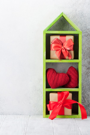 Valentines day greeting card with gift boxes and knitted hearts. With space for your greetings 写真素材