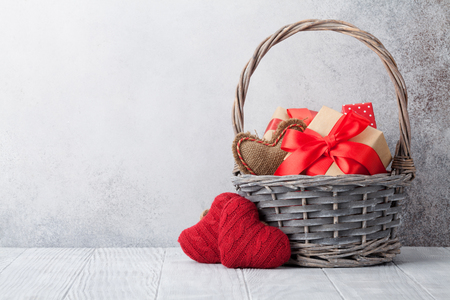 Valentines day greeting card with gift boxes in basket. With space for your greetings 写真素材