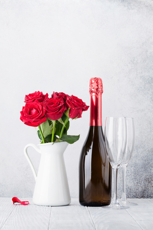 Valentine's day greeting card with red rose flowers bouquet and champagne. With space for your greetings