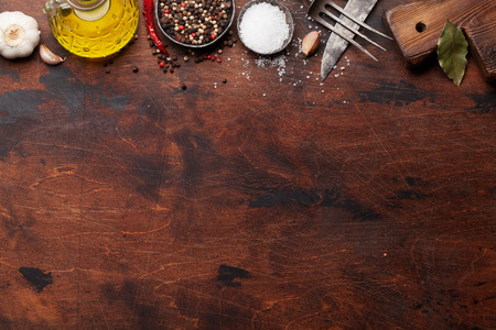 Set of various spices and herbs on wooden table. Top view with space for your recipe. Flat lay