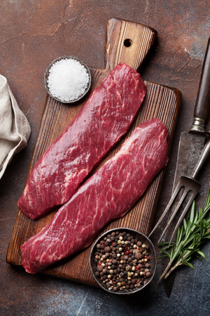 Raw top blade or denver steak cooking on cutting board cooking. Top view Stock fotó - 115899316