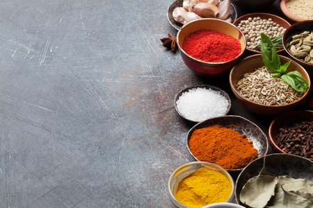 Set of various spices and herbs on stone background. With space for your recipe