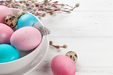 Easter greeting card with pussy willow and colorful easter eggs on wooden table. With space for your greetings Stock fotó