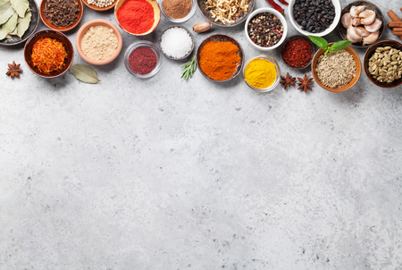 Set of various spices and herbs on stone background. Top view with space for your recipe. Flat lay 写真素材