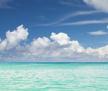Summer tropical sea and blue sky with clouds. Perfect vacation landscape