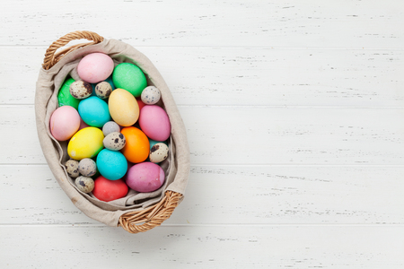 Easter greeting card with colorful eggs in basket.