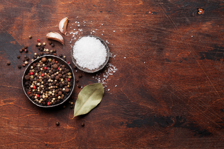 Spices for meat. Salt and pepper on wooden cooking table. Top view with space for your text