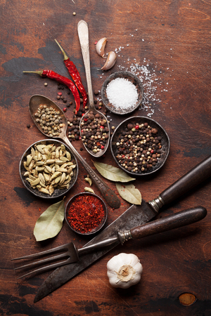 Set of various spices and herbs on wooden background. Top view. Flat lay