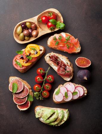 Brushetta or traditional spanish tapas. Appetizers italian antipasti snacks set. Top view and flat lay
