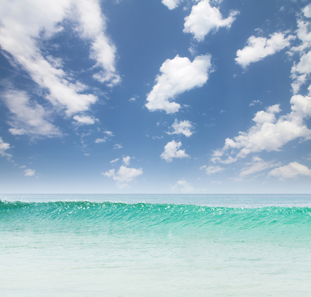 Summer tropical sea with waves and blue sky with clouds. Perfect vacation landscape 写真素材