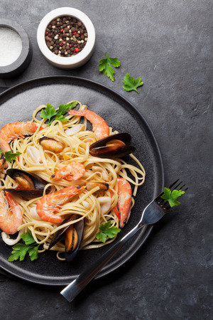 Spaghetti seafood pasta with clams and prawns. Top view with space for your text
