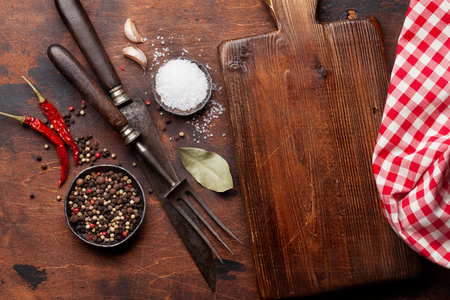 Various spices, herbs and cooking utensils on wooden background. Top view with space for your recipe. Flat lay