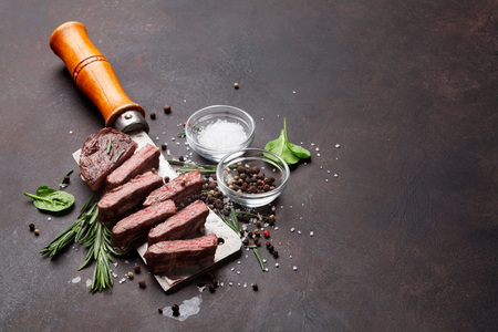 Top blade or denver grilled steak over meat butcher knife. With copy space Stock Photo