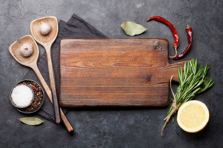 Cooking ingredients and utensils on stone table. Top view with copy space on cutting board Zdjęcie Seryjne