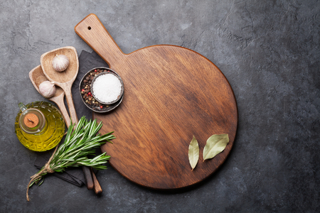 Cooking ingredients and utensils on stone table. Top view with copy space on cutting board Imagens