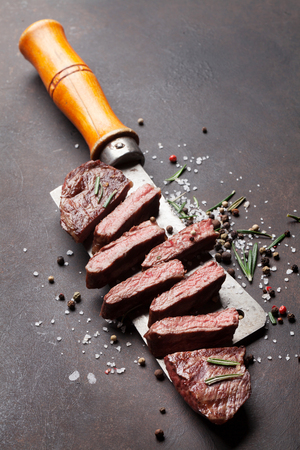 Top blade or denver grilled steak over meat butcher knife