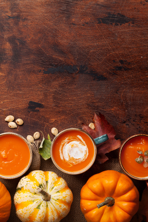 Autumn vegetarian pumpkin cream soup. Top view with copy space Zdjęcie Seryjne