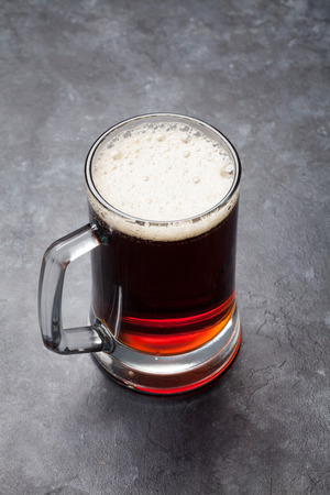 Glass of dark porter beer on stone table