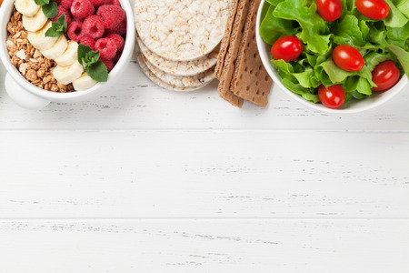 Healthy food concept. Salad, fruits, vegetables and cereal. Top view flat lay with copy space for your text Stock Photo