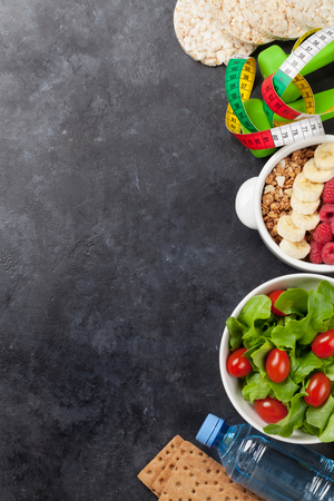 Healthy food concept. Salad, fruits, vegetables, nuts and cereal. Top view flat lay with copy space for your text Stock Photo